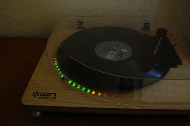 Turntable with lit LEDs along the diameter of the record it's playing